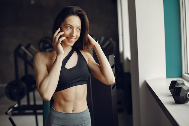 A beautiful girl is engaged in a gym Free Photo