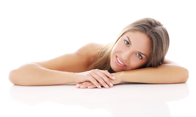 Beautiful girl lying on her arm Free Photo