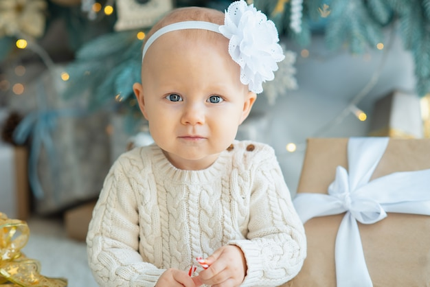 Beautiful girl near decorated christmas tree Premium Photo