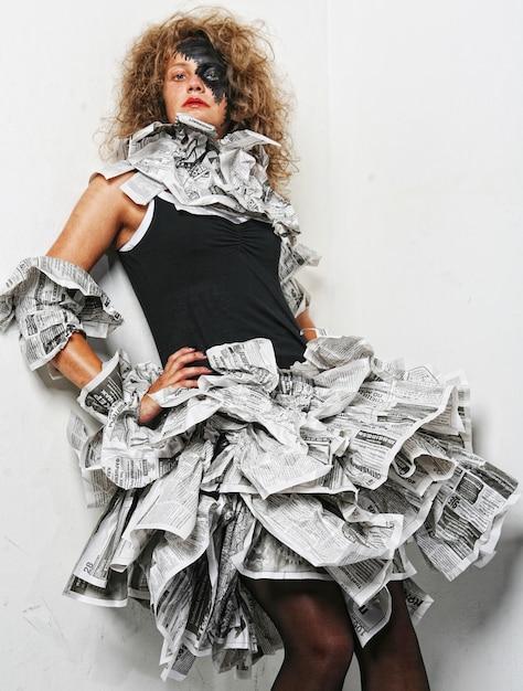 Beautiful girl in a newspaper dress Premium Photo