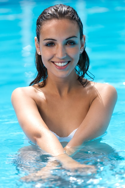 Beautiful girl posing in the swimming pool photo free download beautiful girl posing in the swimming pool free photo voltagebd Image collections
