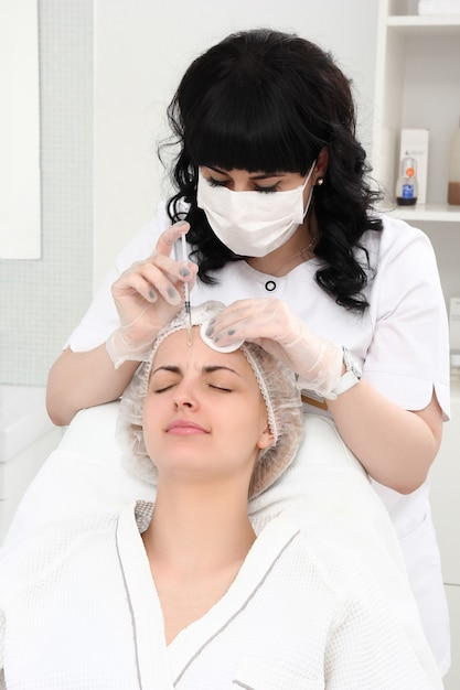 Beautiful girl on rejuvenation procedure in beauty clinic Premium Photo