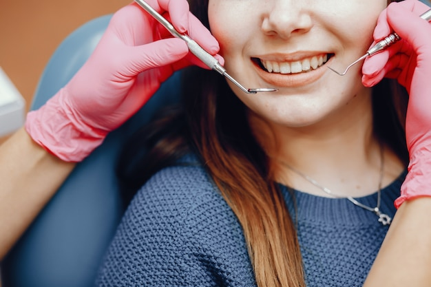 Beautiful girl sitting in the dentist's office Free Photo
