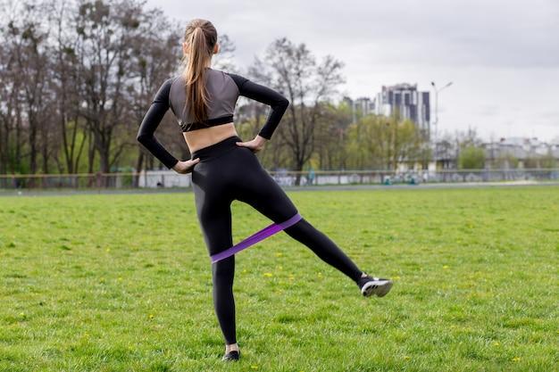 Beautiful girl in sportswear exercising outdoors Premium Photo