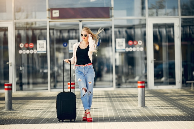 Beautiful girl standing in airport Free Photo