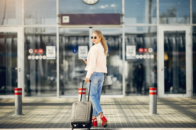 Beautiful girl standing in airport Free Photo