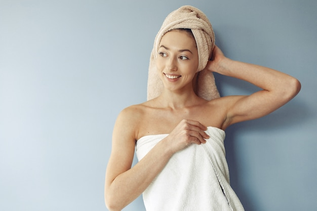 Beautiful girl standing  in a towel Free Photo