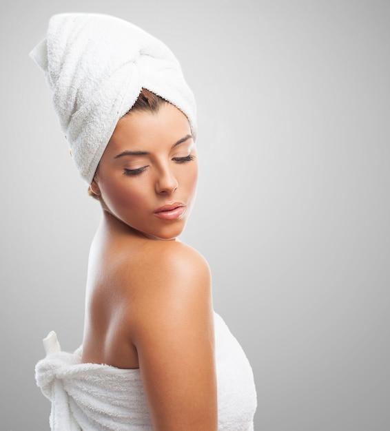 Beautiful girl in towel looking down Free Photo