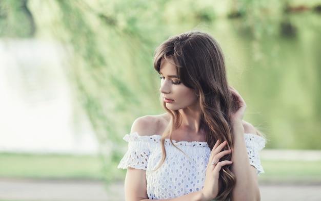 Beautiful girl in a white dress Premium Photo