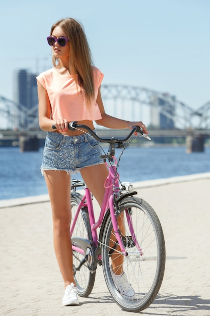 Beautiful girl with bike Free Photo