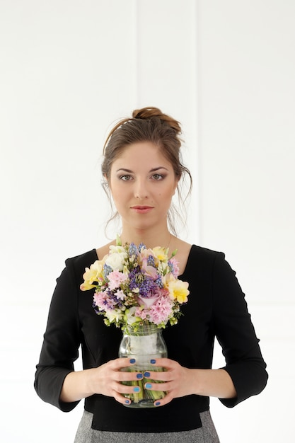 Beautiful girl with bouquet Free Photo