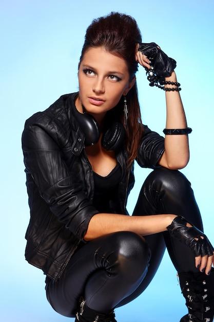 Beautiful girl with headphones and disco ball Free Photo