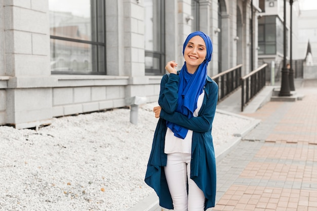 Beautiful girl with hijab smiling outdoors Free Photo