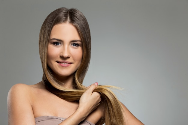 Beautiful girl with long hair Free Photo