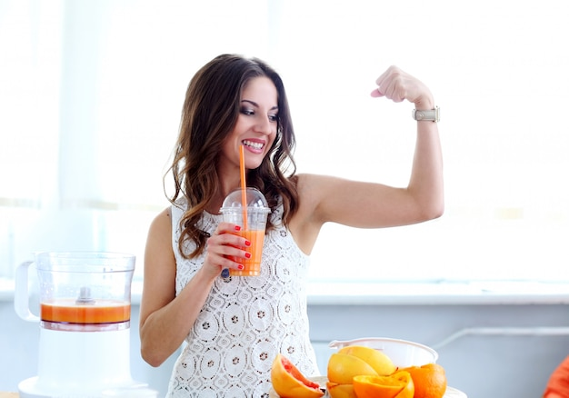 Beautiful girl with orange juice Free Photo