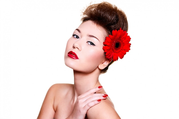 Beautiful girl with red lips flower on her hair Free Photo
