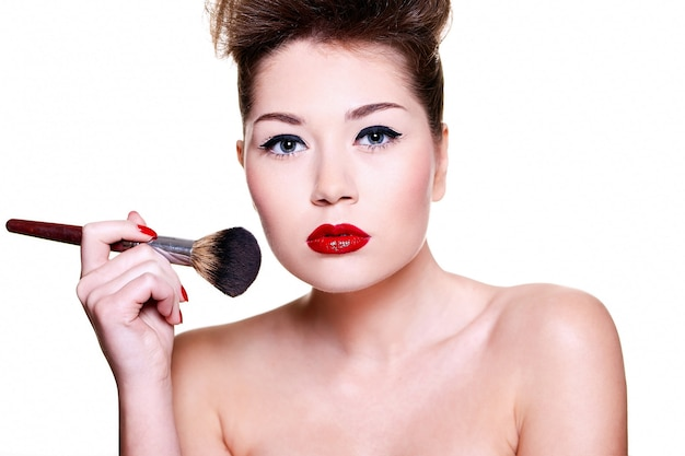 Beautiful girl with red lips and nails Free Photo
