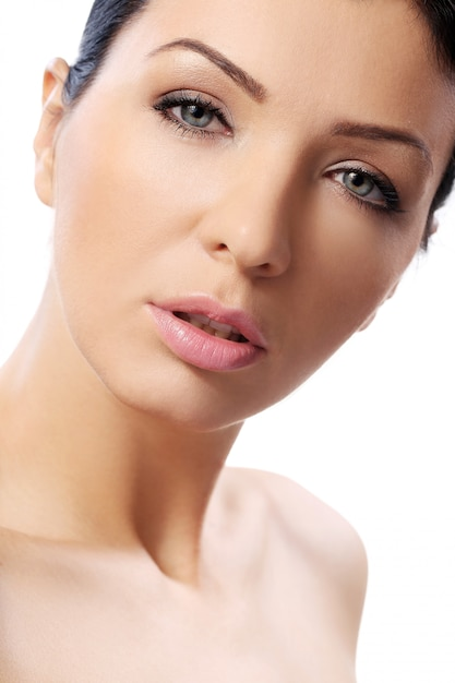 Beautiful girl with serious look and perfect skin Free Photo