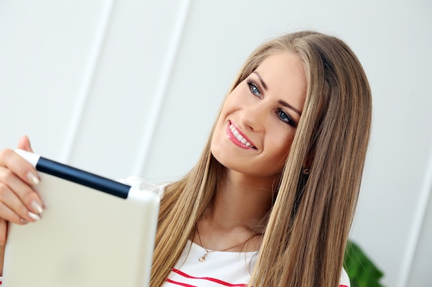 Beautiful girl with tablet Free Photo