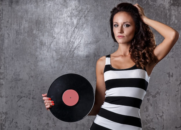 Beautiful girl with vinyl disc Free Photo