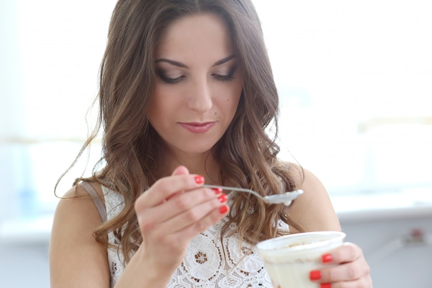 Beautiful girl with yoghurt Free Photo