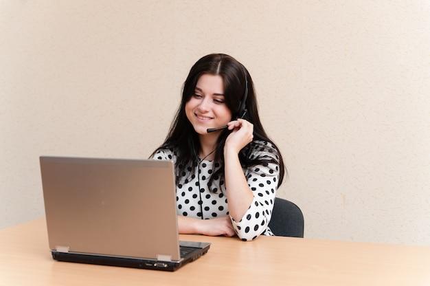 Beautiful girl works for laptop Premium Photo