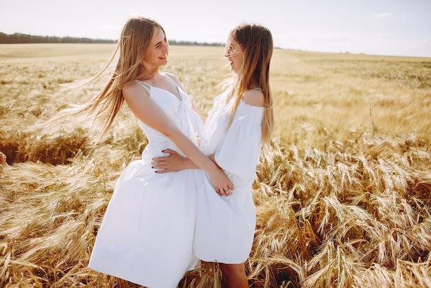 Beautiful girls in an autumn field Free Photo