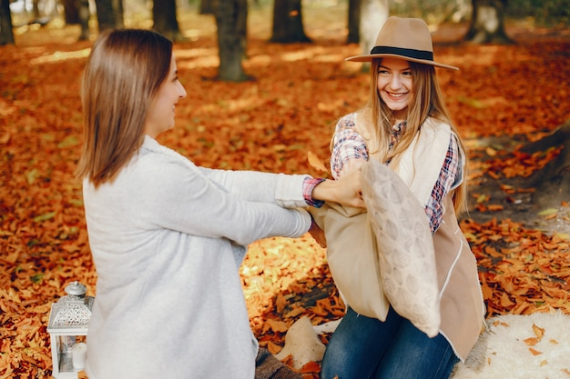 Beautiful girls have fun in a autumn park Free Photo