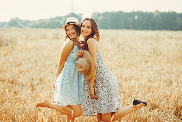 Beautiful girls have a rest in a field Free Photo