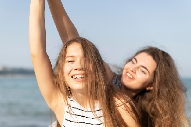 Beautiful girls having fun at beach Free Photo
