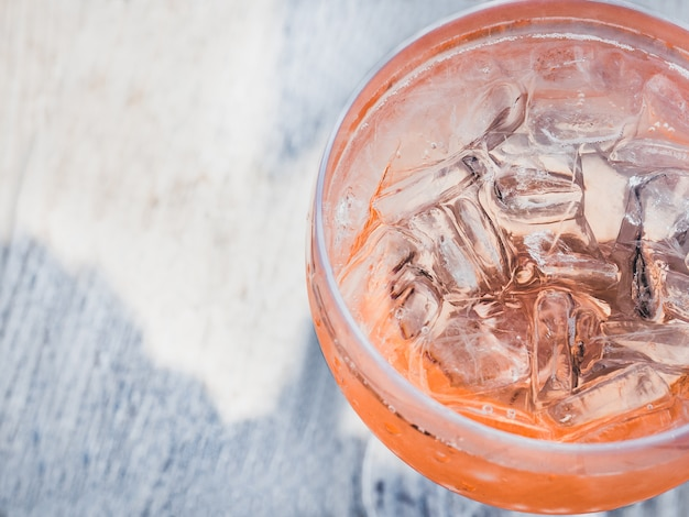 Beautiful glass with a pink cocktail and ice cubes Premium Photo