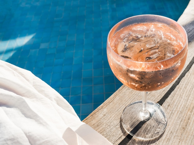 Beautiful glass with a pink cocktail Premium Photo