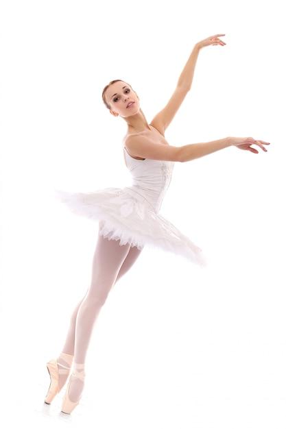 Beautiful and gorgeous ballerina in ballete pose Free Photo