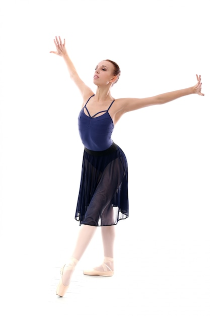 Beautiful and gorgeous ballerina in ballete pose Free Photo