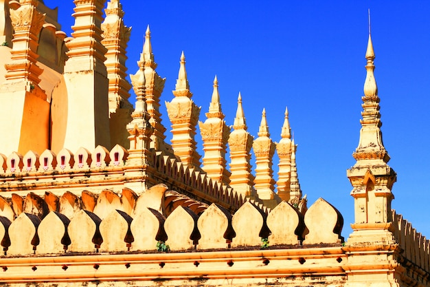 Beautiful great golden pagoda in buddhist temple with blue sky Premium Photo