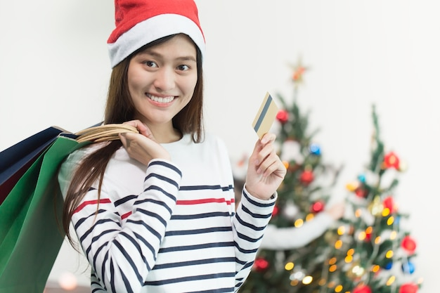 Premium Photo Beautiful Happy Asian Girl With Credit Card In Her Hand Christmas Shopping Concept