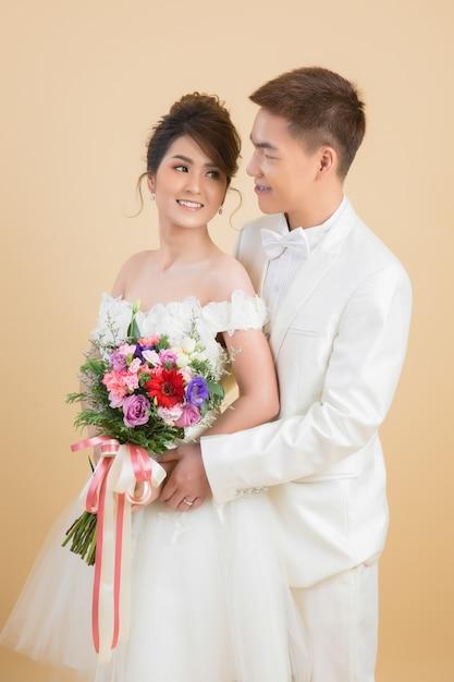 Beautiful happy couple in wedding in studio Free Photo