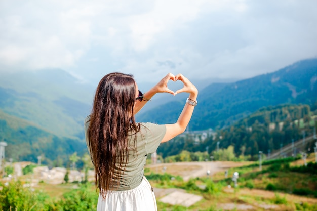 Beautiful happy young woman in mountains in the scene of fog Premium Photo
