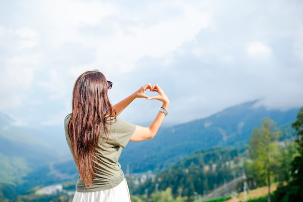 Beautiful happy young woman in mountains Premium Photo