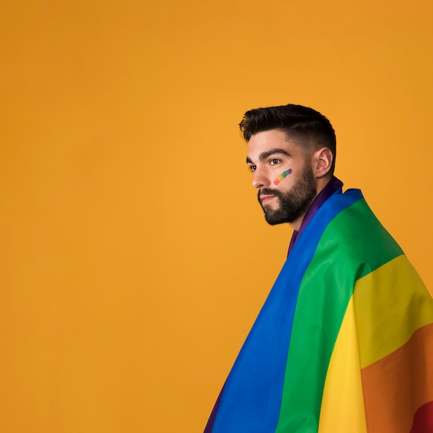 Beautiful homosexual wrapping in rainbow flag Free Photo