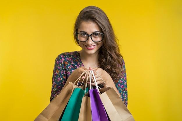 Beautiful Indian Girl Holding Shopping Bags Premium Photo
