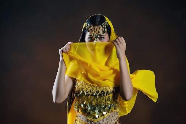 Beautiful indian young hindu woman model.traditional indian costume yellow saree . Free Photo