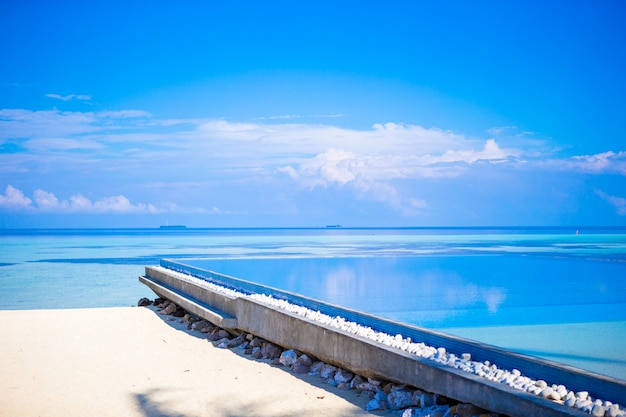 Beautiful infinity swimming pool in luxury resort at tropical country Premium Photo