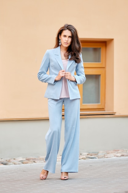 Beautiful lady in skyblue pantsuit on the street Premium Photo