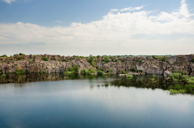 Beautiful lake in abandoned granite quarry. Premium Photo