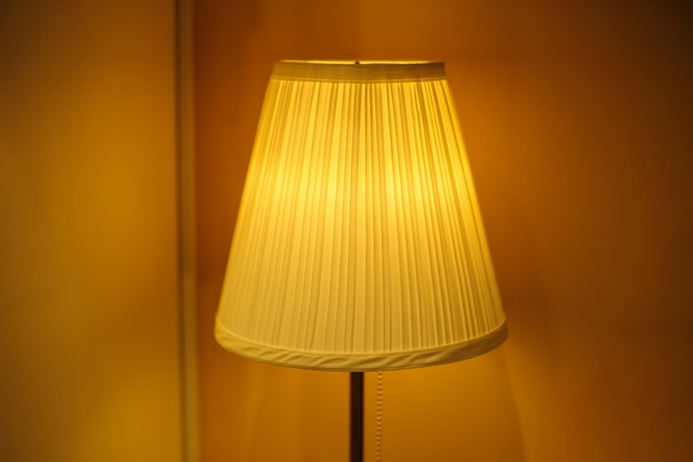 Beautiful lampshade in bedroom with place for text Premium Photo