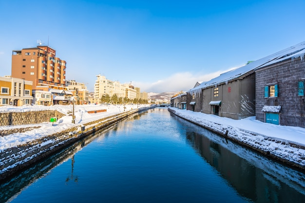 Beautiful landscape and cityscape of otaru canal river in winter and snow season Free Photo
