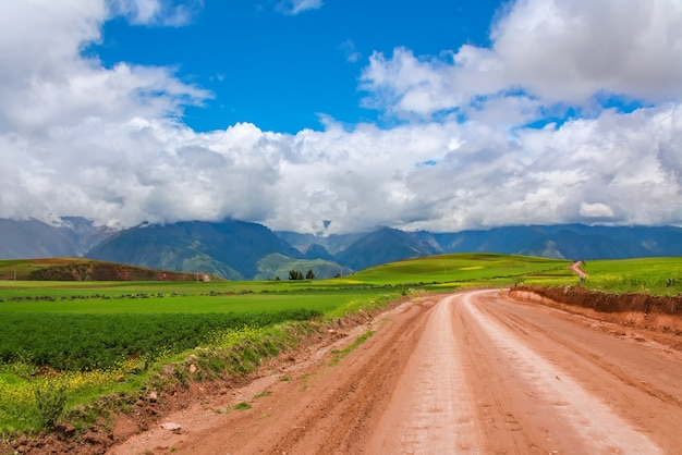 Beautiful landscape of gravel road, fields, meadows and mountains in peru, south america Premium Photo