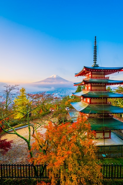 Beautiful landscape of mountain fuji with chureito pagoda around maple leaf tree in autumn season Free Photo