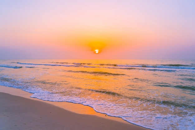 Beautiful landscape outdoor sea ocean and beach at sunrise or sunset time Free Photo